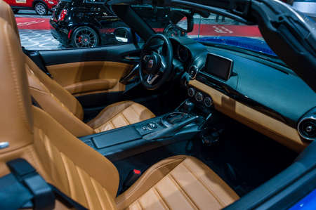 car dealers: New York, USA - March 24, 2016: Fiat 124 Spider interior on display during the New York International Auto Show at the Jacob Javits Center.