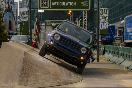 trade off: New York, USA - March 24, 2016: Jeep on the off road course during the New York International Auto Show at the Jacob Javits Center.