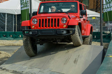 trade off: New York, USA - March 24, 2016: Jeep Wrangler Rubicon on the off road course during the New York International Auto Show at the Jacob Javits Center.