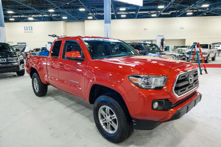 tacoma: Miami Beach, FL, USA - November 6, 2015:  Toyota Tacoma on display during the 2015 Miami International Auto Show at the Miami Beach Convention Center in downtown Miami Beach.