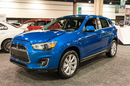 outlander: CHARLOTTE, NC, USA - November 11, 2015: Mitsubishi Outlander Sport on display during the 2015 Charlotte International Auto Show at the Charlotte Convention Center in downtown Charlotte. Editorial