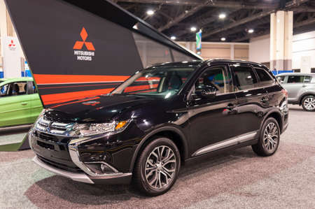 outlander: CHARLOTTE, NC, USA - November 11, 2015: Mitsubishi Outlander on display during the 2015 Charlotte International Auto Show at the Charlotte Convention Center in downtown Charlotte. Editorial