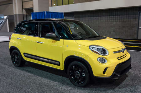 fiat: CHARLOTTE, NC, USA - November 11, 2015:  Fiat 500L on display during the 2015 Charlotte International Auto Show at the Charlotte Convention Center in downtown Charlotte. Editorial