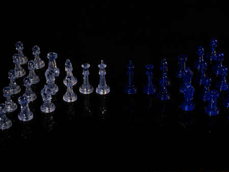 Chess pieces, strategy game. It is played on a board of 64 black and white squares.