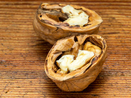 Nut, dried fruit, very hard shell and edible and very fatty seed, produced by walnut.