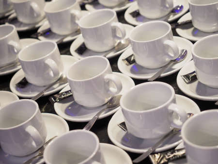 Cups prepared for a coffe break at a business meeting.