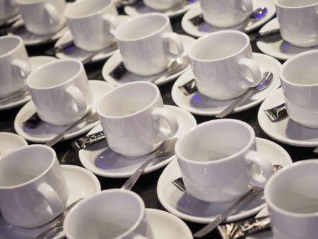 Cups prepared for a coffe break at a business meeting. Archivio Fotografico - 149594764