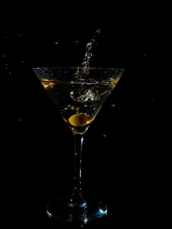 Dry Martini glass on black background