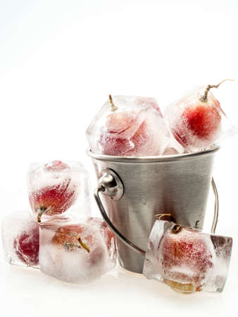 Grape inside ice on white background