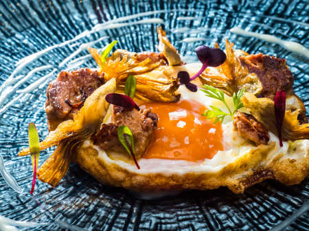 fried egg with salmon and caviar