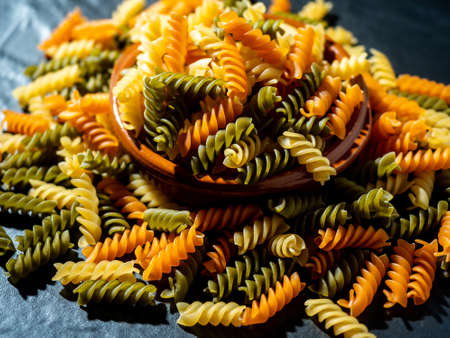 Hard pasta made from wheat flour, typical food from Italy, with great calorific value and high content of fast absorbing carbohydrates. Stock Photo