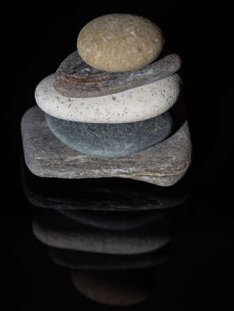 Stacked and reflected stones on black background Stok Fotoğraf