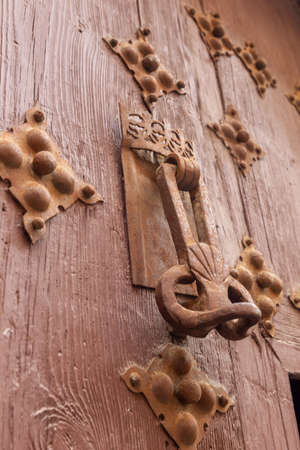 Old wooden doors and knockers in the city of Segovia, in Castilla y Leon, Spain.
