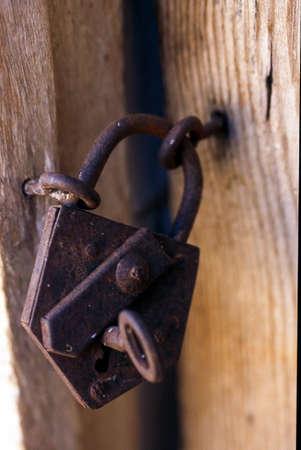 Wooden door with old lock.