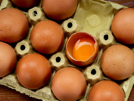 Eggs in an egg cup, on a wooden table