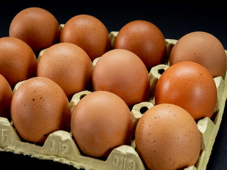 Group of eggs in balance on a black background