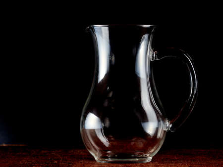 The contours of and empty glass jug