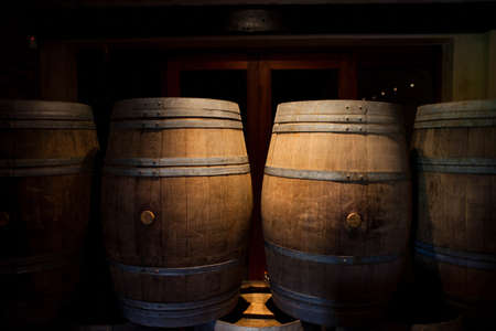 south western: Barrels of South African wine in a wine cellar Stock Photo