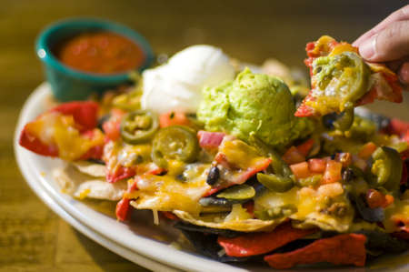 Nachos with cheese, guacamole, and sour cream