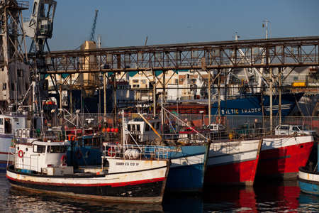 Fishing boats docked in Cape Town harbor, South Africa