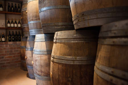 Barrels of South African wine stacked for sale Standard-Bild