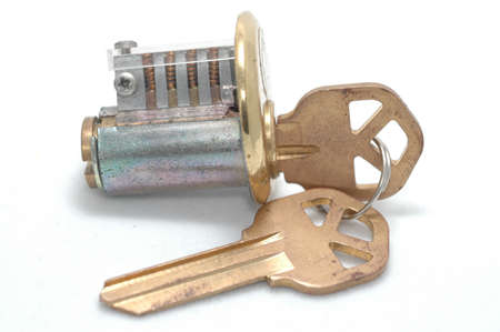 Cutaway pin-tumbler lock with the correct key inserted Stock Photo - 13566531
