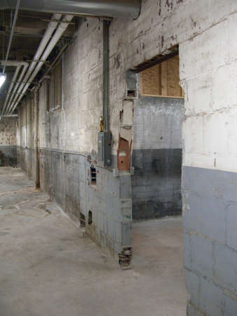 Empty older warehouse  industrial space with grey  white walls photo