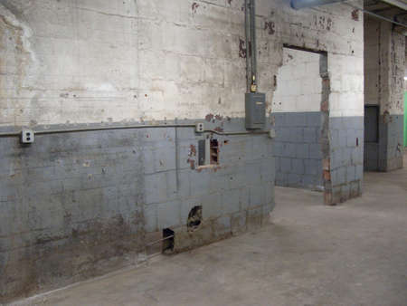 Empty older warehouse / industrial space with grey  white walls Stock Photo - 13566948