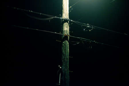 Telephone wires on a foggy night photo