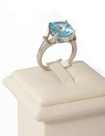 Ring with blue stone on display stand photo