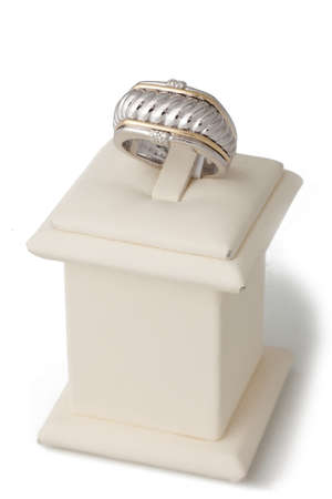ring stand: Gold and silver ring on display stand Stock Photo