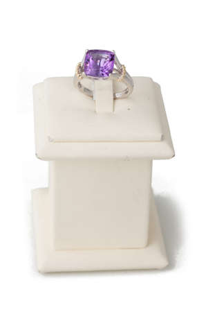ring stand: Ring with purple stone on display stand