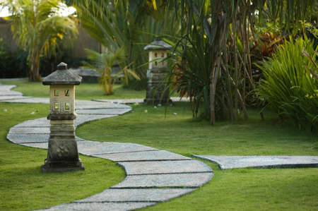 garden lamp: Curving traditional garden path in Bali, Indonesia Stock Photo