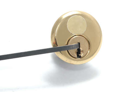 Picking a pin-tumbler lock with a tension wrench Stock Photo - 15814876