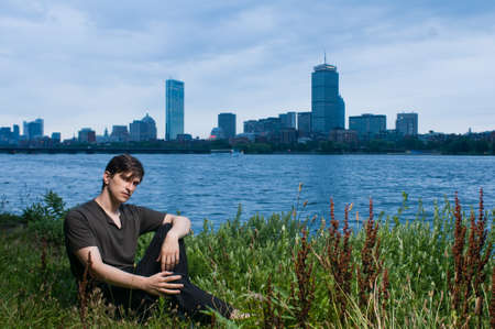 Young man at edge of the Charles River, Boston photo