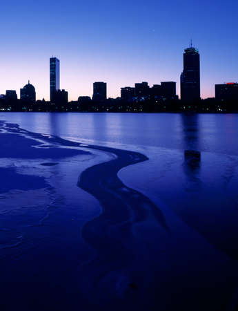 Bostons Back Bay with the Charles River frozen over Stock Photo