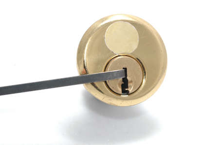 Picking a pin-tumbler lock with a tension wrench Stock Photo - 15899639