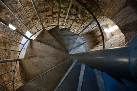 Medieval spiral staircase in a tower looking down photo