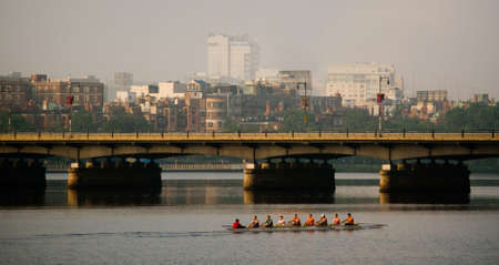 Rowers on the Charles River at sunrise Stock Photo