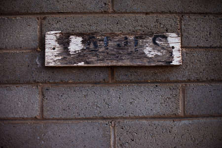 Worn and weathered ladies' room sign in rural Australia photo