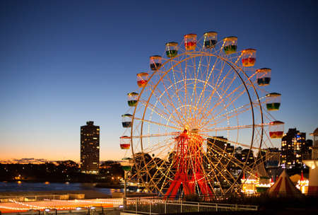 Sydneys Luna Park ferris wheel at sunset.