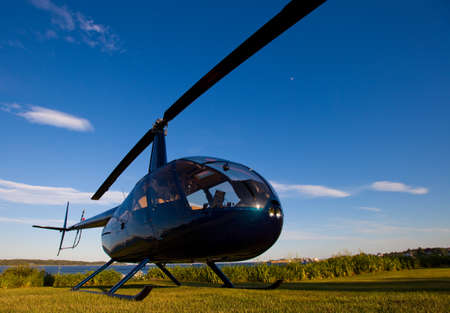 Robinson R-44 ready for takeoff in late afternoon Standard-Bild