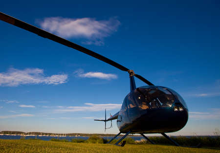 Robinson R-44 ready for takeoff in late afternoon Stock Photo