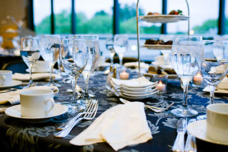 Elegant place settings at a formal banquet photo