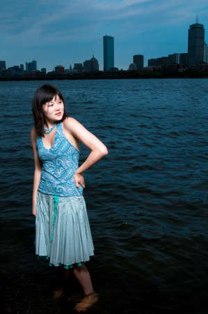 Asian girl at the edge of the Charles River photo
