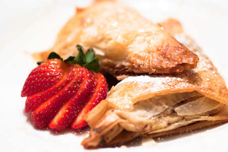flaky: Filled Apple Pastries with Strawberries and Sugar