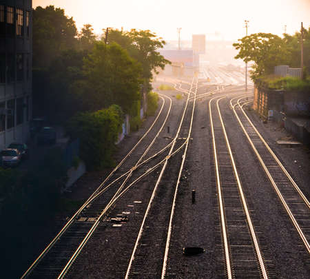 Train tracks at dawn in western Cambridge, Massachusetts photo