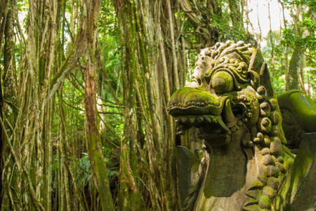 Ancient stone sculpture in the Balinese jungle photo