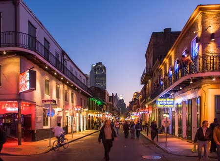 NEW ORLEANS, USA - CIRCA MARCH 2008: Crowds of people and neon lights at dusk circa March 2008 in New Orleans, USA. Tourism is the area's major source of income after Hurricane Katrina in 2005. Redakční