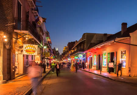 bourbon street: NEW ORLEANS, USA - CIRCA MARCH 2008: Crowds of people and neon lights at dusk circa March 2008 in New Orleans, USA. Tourism is the areas major source of income after Hurricane Katrina in 2005. Editorial
